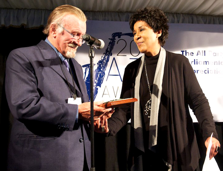 Acker receives his award from Moira Stewart