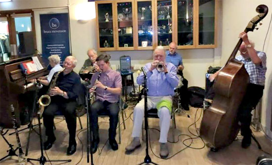 """Reece at The Edinburgh Jazz 'n Jive Club with Vi Mills' """"The Spirits of Rhythm"""". Vi on piano, Ian on reeds, Jim Petrie on cornet, Kenny Milne on drums, Dizzy Jackson on bass, Brian Weld on banjo and, yes, me sitting in on clarinet!"""