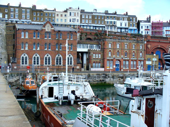 Military Road, Ramsgate Facing the Inner Harbour are the Seaman's Church and the Ramsgate Home for Smack Boys. Above, on the cliff, are the terraced buildings of Royal Parade.