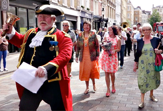 Town Cryer Alan Myatt Heads the Parade