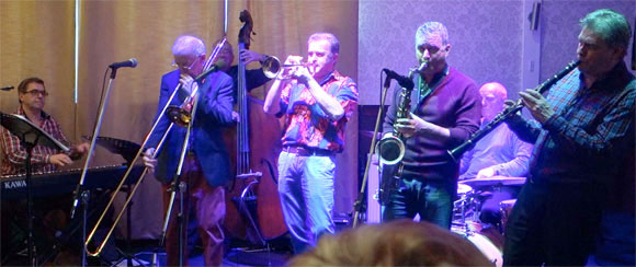At The Walnut Tree: Alan Haughton (piano), Tad Newton (trombone), Tomas Pedersen (bass), Gary Wood (trumpet), Richard Exall (Guesting on Saxophone), Ronnie Fenn (drums), Trevor Whiting (clarinet)